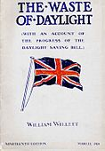 "Pamphlet cover showing a large British flag in red, white, and dark blue, with the large title ""THE WASTE OF DAYLIGHT"", an unreadable subtitle, and ""WILLIAM WILLETT"" near the bottom."