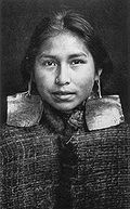 Kwagu'ł girl, Margaret Frank (nee Wilson) wearing abalone shell earings. Abalone shell earings were a sign of nobility and only worn by members of this class.