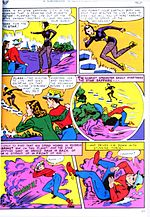 "A page taken from All-Flash Comics #32, showing the Flash and a woman in a coat standing on an alien planet with a yellow sky and violet sand. They are watching a woman in a violet costume escape up a floating stairway she's made using her super powers, and she tells the two they only have two minutes to live unless a device is reached in time. Flash tries to follow her using his super speed but falls to the ground with ""stunning force"" because speed is reversed on this planet."