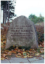"A roughly dressed block of granite, about waist-high, the inscription reading ""Am 1.8.1963 wurde 150 m von hier HELMUT KLEINERT vor dem Überschreiten der Demarkationslinie eschossen""."