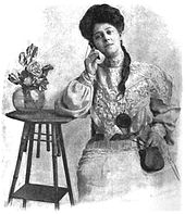 Victorian lady listening to electrical device