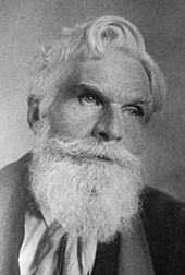 Portrait photo of Havelock Ellis, an older man with white hair and a long beard and piercing eyes