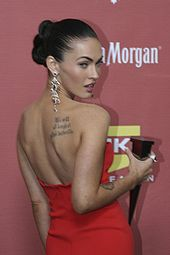 "Photograph showing Megan Fox's tattoo of the quote ""We will all laugh at gilded butterflies"" and a partial view of her tattoo of Marilyn Monroe's face"