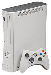 Xbox 360 Arcade console with white wireless controller.