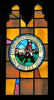 Stained-glass window in Norwood town hall depicting town seal. It was suggested in 2006 that Guild's red coat must surely be historically inaccurate.[9]