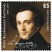 postage stamp showing on a dark background a head-and-shoulders portrait of a dark-haired, narrow faced, middle-aged man looking out at the viewer, weating a high collar and dark coat; text comprises 'Felix Mendelssohn Bartholdy', the dates 1809–1847, a facsimile of Mendelssohn's signature,the figure 65 and the word 'Deutschland'