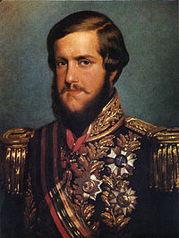 Painted portrait of a young man with auburn hair and a full beard who wears a heavily embroidered military-type tunic bedecked with medals and a sash of office across the chest