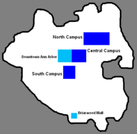 Black outline of city with three blues blocks in the center, one cyan block in the center, and one cyan block at the bottom inside the black outline