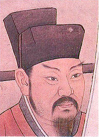A head-shot style painting of a middle aged to late middle aged man with pointed eyebrows, sideburns, a mustache, and a beard. He is wearing a red robe and a black, square cut hat.