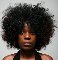 Woman wearing a loose Afro.