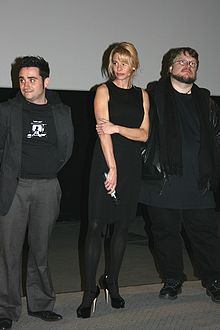 Juan Antonio Bayona, Belén Rueda and Guillermo del Toro dressed in black on a stage from left to right.