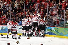 Hockey players and fans celebrating