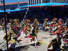 A Diablada dance squad passing through the streets of Oruro.