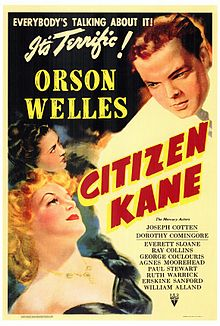 "Poster showing two women in the bottom left of the picture looking up towards a man in a white suit in the top right of the picture. ""Everybody's talking about it. It's terrific!"" appears in the top right of the picture. ""Orson Welles"" appears in block letters between the women and the man in the white suit. ""Citizen Kane"" appears in red and yellow block letters tipped 60° to the right. The remaining credits are listed in fine print in the bottom right."