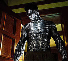 Daniel Cudmore as Colossus in a scene where he is entering a reoom in pajama bottoms and in his armored form.