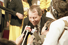 Colour photograph of former Federal Minister for Indian Affairs and Northern Development, the Honourable David Crombie speaking to reporters on the floor of the 1983 Progressive Conservative leadership convention