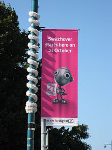 "Digital Switchover banner with text saying ""Switchover starts here on 21 October"""
