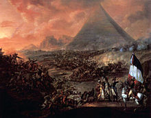 Cavalry battlescene with pyramids in background