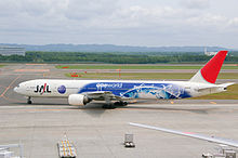 A Japan Airlines Boeing 777-300 painted in special oneworld livery, taxiing at New Chitose Airport