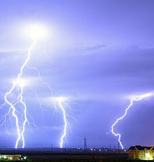 Four bolts of lightning strike the ground