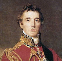 Head and shoulders portrait of middle-aged man looking towards the viewer. He wears a red tunic with gold braid finishing.