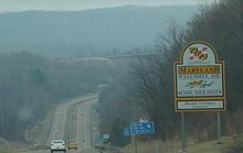 "A sign adjacent to a four-lane highway reads ""Maryland welcomes you. Enjoy your visit! Martin O'Malley, Governor"""