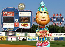 "A bobblehead depicting an unhappy bearded man wearing a yellow and blue robe and hat holding a sign reading, ""Nineveh or bust"""