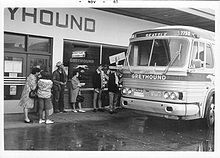Passengers mounting bus at Greyhound bus station