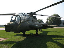 Quarter front view of the AH-56's front fuselage and canopy, showing the canopy to advantage. The aircraft is parked on a grassy surface for museum display.