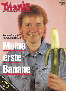 """Titanic"" magazine cover showing a smiling young woman with a denim jacket and home-made perm holding a large cucumber peeled in the style of a banana"