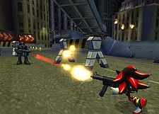 The hedgehog from the cover shoots a single bullet from a machine gun-like firearm at a human soldier who attempts to do the same. The setting is a disheveled city street at night with tall buildings surrounding the area and an elevated highway overhead.