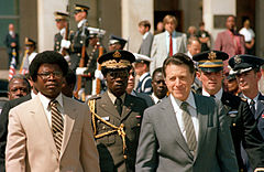 President Samuel Doe walks with U.S. Secretary of Defense Caspar Weinberger during a visit to Washington DC in 1982