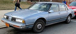 1986-89 Delta 88 sedan. This is a 1988 or 1989 model because the 1986/87 Delta 88s have uncovered headlights