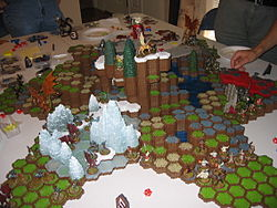 A six-man game of Heroscape using multiple Master Sets and expansion sets.