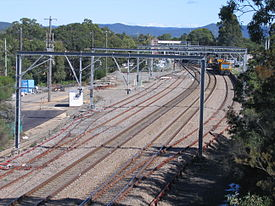 Looking south over Morisset rail yard,with the station in the distance and maintenance trains on a siding