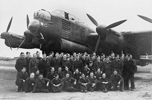 Some of No. 460 Squadron RAAF's ground crew posing in front of the bomber G for George in May 1944