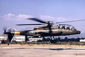 A side view of an AH-56 Cheyenne in hover, a few feet above runway.