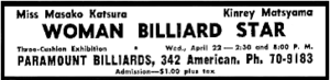 "Rectangular newspaper advertisement with thick black border, centered prominently is the text ""WOMAN BILLIARD STAR""; the balance of the content describes the participants and the time, date and place of the exhibition advertised."
