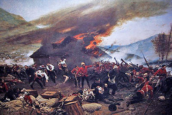 Burning hut in the background; red-jacketed soldiers fighting in the foreground