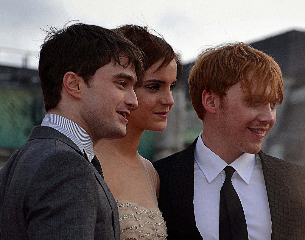 Watson with Daniel Radcliffe (left) and Rupert Grint at the London ...
