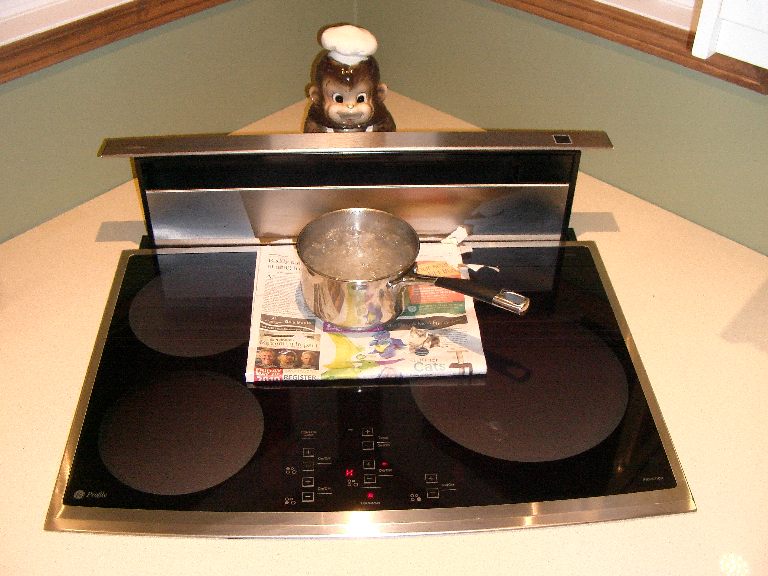 An induction cooktop boiling water through several thicknesses of