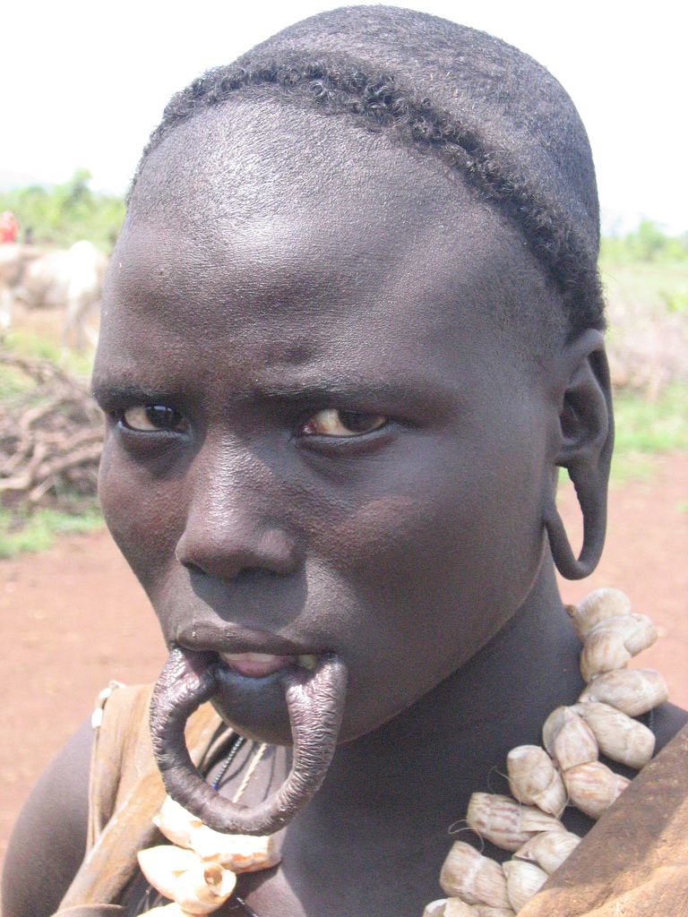 african tribal women with large ear gauges