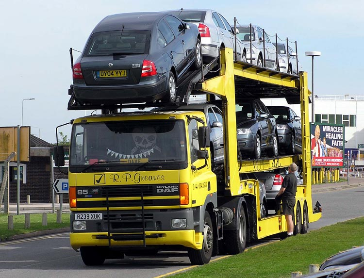 transport semi-trailer carrying Škoda Octavia cars in Cardiff, Wales